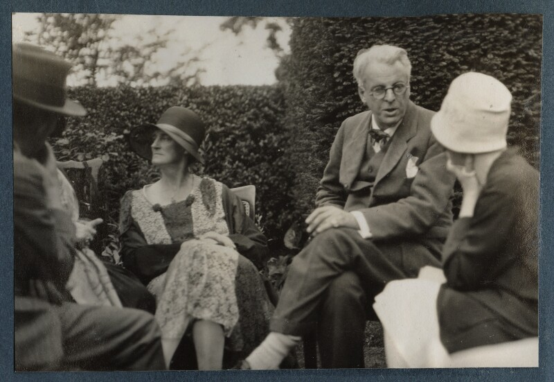 Walter de la Mare; Bertha Georgie Yeats (née Hyde-Lees); W.B. Yeats and an unknown woman, by Lady Ottoline Morrell, Summer 1930 - NPG Ax143157 - © National Portrait Gallery, London