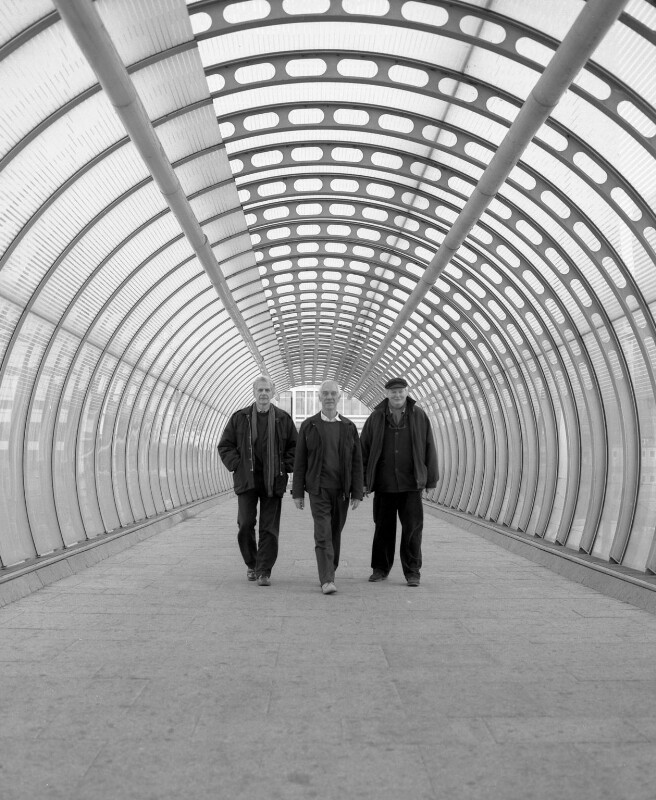 Ahrends, Burton and Koralek architects (Peter Ahrends; Richard St John Vladimir Burton; Paul George Koralek), by Valerie Bennett, 2005 - NPG x128189 - © Valerie Bennett / National Portrait Gallery, London