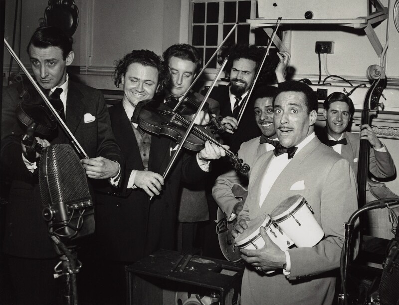The Goons (Spike Milligan; Sir Harry Donald Secombe; Peter Sellers; Michael Bentine) with Ray Ellington and his band, by Walter Hanlon, 1952 - NPG x128883 - © estate of Walter Hanlon