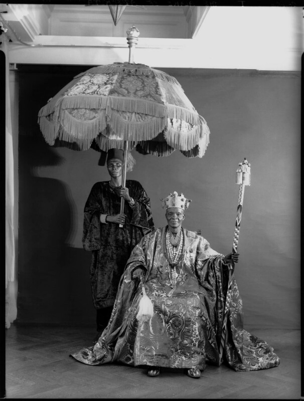 Ladapo Samuel Ademola II, King of Abeokuta and an unknown attendant, by Hay Wrightson, 11 June 1937 - NPG x132173 - © National Portrait Gallery, London