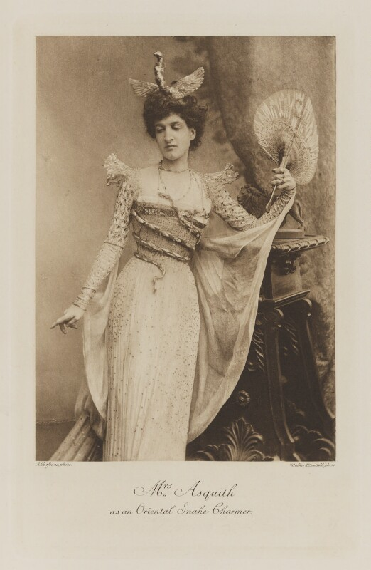 Margaret Emma Alice ('Margot') Asquith (née Tennant), Countess of Oxford and Asquith as an Oriental Snake Charmer, by Alexander Bassano, photogravure by  Walker & Boutall, 1897; published 1899 - NPG Ax41108 - © National Portrait Gallery, London