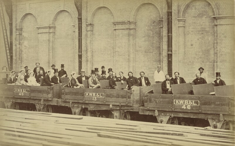 Group photo at Kensington High Street Station including Lady Edith Campbell, Arthur Philip Stanhope and Count Arrivabene, by Unknown photographer, July 1868 - NPG x27688 - © National Portrait Gallery, London