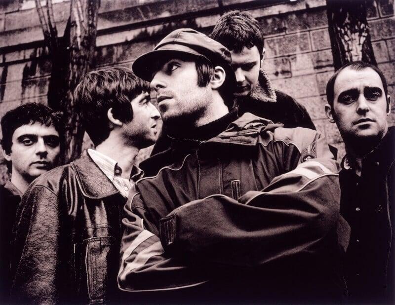 Oasis (Guigsy McGuigan; Noel David Thomas Gallagher; Liam Gallagher; Alan White; Paul ('Bonehead') Arthurs), by Jill Furmanovsky, 23 November 1995 - NPG x87862 - © Jill Furmanovsky