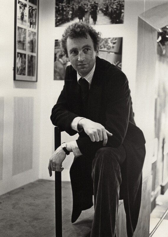 Patrick Procktor during the installation of 'Happy and Glorious: 130 Years of Royal Photographs', possibly by Ernestine ('Nesta') MacDonald (née Rosse), 1977 - NPG x134694 - © reserved; collection National Portrait Gallery, London