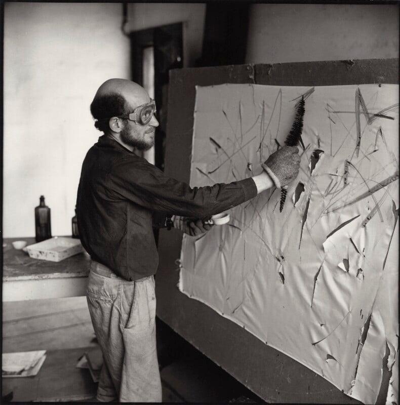 Gustav Metzger practicing for a public demonstration of Auto-destructive art using acid on nylon, possibly by John Cox, for  Ida Kar, 1960 - NPG x134796 - © National Portrait Gallery, London