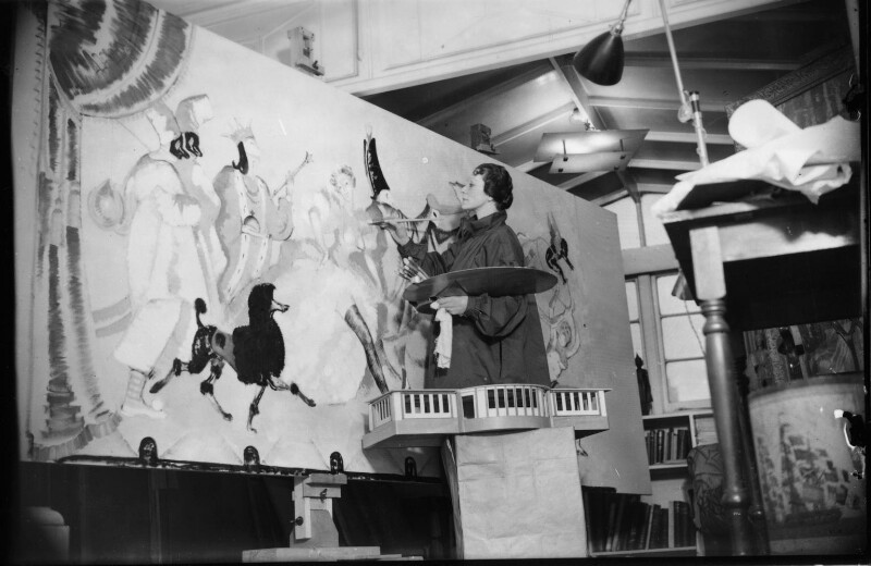 Doris Zinkeisen working on the panels for the Grill Room of the Queen Mary, by Harold Tomlin, for  Daily Herald, 8 January 1936 - NPG x135105 - © Science & Society Picture Library / National Portrait Gallery, London