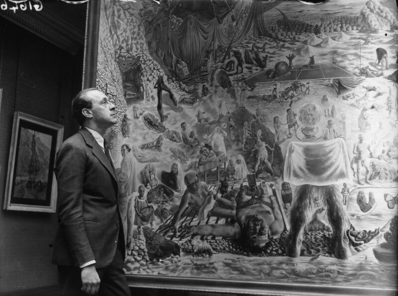 Pavel Tchelitchew with his painting 'Phenomena' at Tooth's Gallery, by Reg Sayers, for  Daily Herald, 15 June 1938 - NPG x135106 - © Science & Society Picture Library / National Portrait Gallery, London
