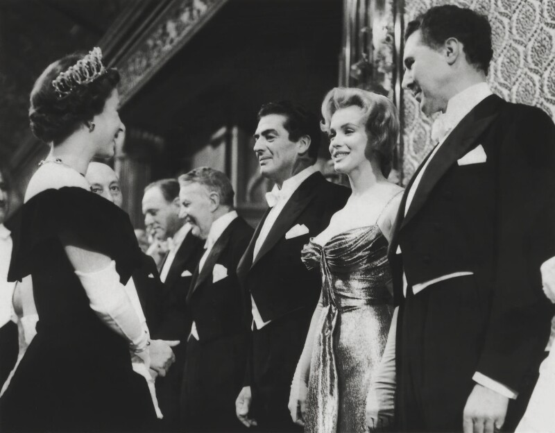 Queen Elizabeth II; Marilyn Monroe; Victor John Mature; Anthony Quayle, by Unknown photographer, for  Daily Mirror, 29 October 1956 - NPG x136606 - © reserved; National Portrait Gallery, London
