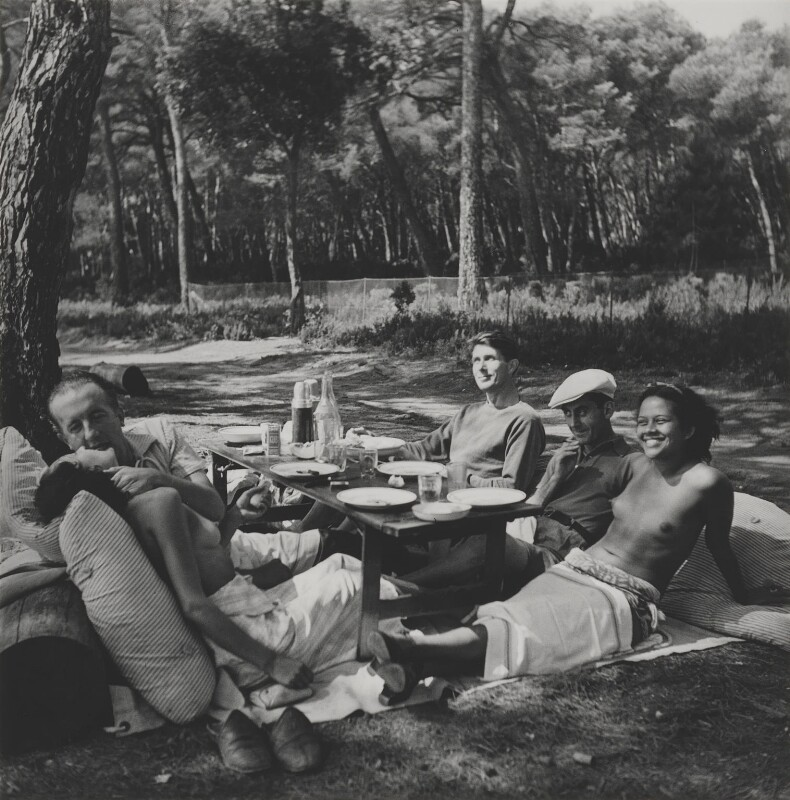 Picnic (Nusch Eluard, Paul Eluard, Sir Roland Algernon Penrose, Man Ray (Emmanuel Radnitzky), Adrienne 'Ady' Fidelin), by Lee Miller, 1937 - NPG x137400 - © reserved; collection National Portrait Gallery, London