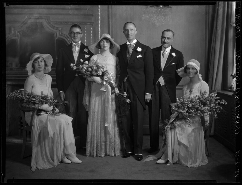 Kathleen Gilda Elliott (née Berry), Ernest George Elliott and wedding party, by Lafayette, 12 August 1930 - NPG x184633 - © National Portrait Gallery, London