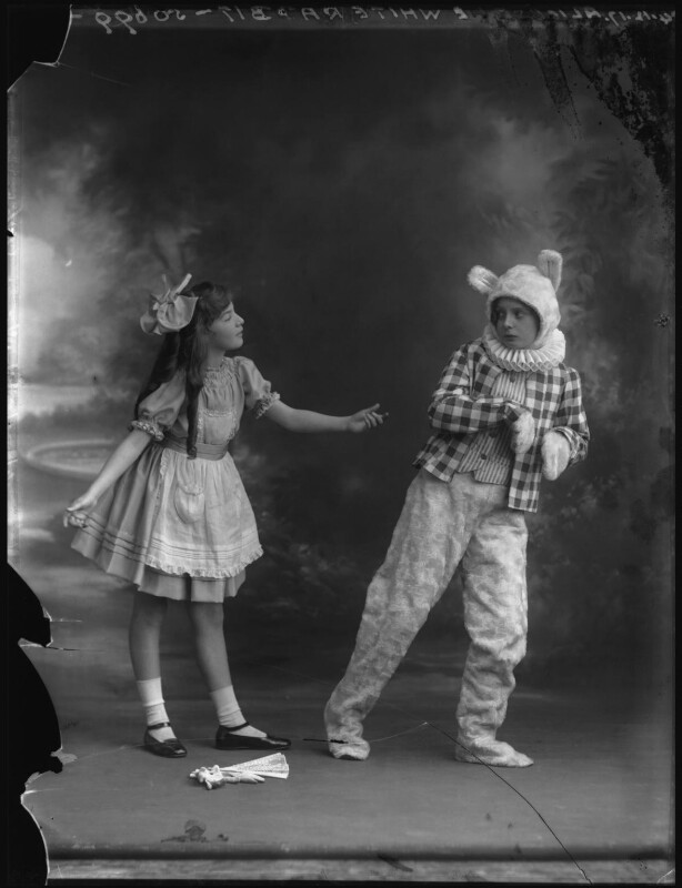 Estelle Dudley as Alice in 'Alice in Wonderland', with boy actor as the White Rabbit, by Bassano Ltd, 14 December 1917 - NPG x34662 - © National Portrait Gallery, London