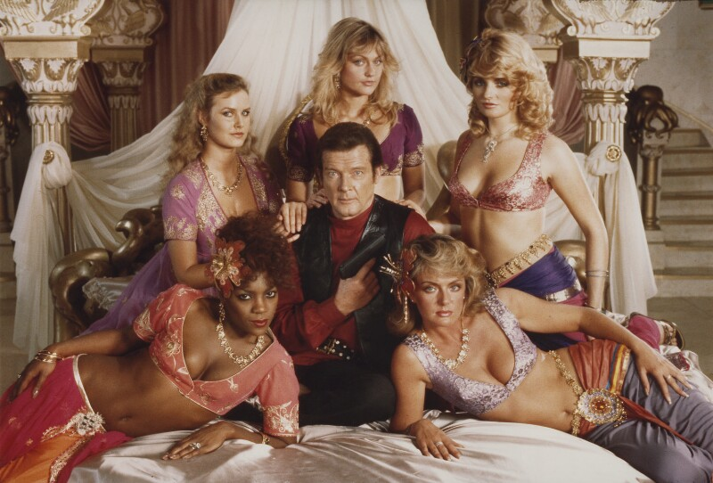 Roger Moore as James Bond with the Bond Girls in 'Octopussy', by Frank Connor, 1982 - NPG x76208 - © reserved; National Portrait Gallery, London