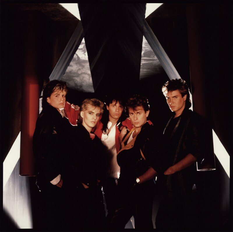 Duran Duran (John Taylor; Nick Rhodes; Andy Taylor; Roger Taylor; Simon Le Bon), by Mike Owen, 1984 - NPG x76428 - © Mike Owen / National Portrait Gallery, London