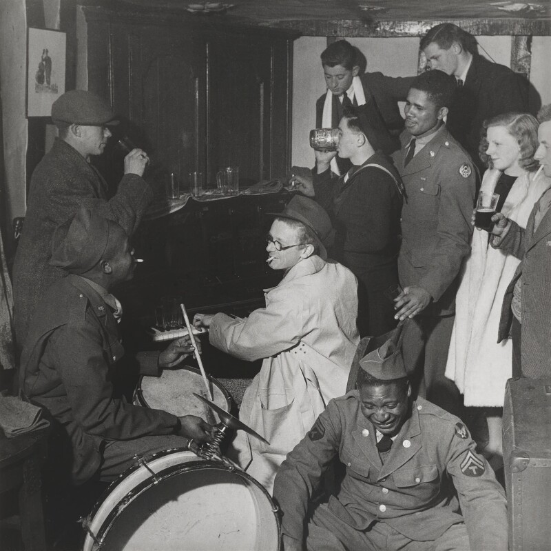 Carl Ronald Giles with his wife Sylvia ('Joan') Clarke and musicians, including Butch Shepherd, by Lee Miller, 1944 - NPG P1078 - © reserved; collection National Portrait Gallery, London