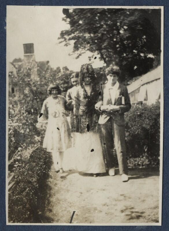 Julian Vinogradoff (née Morrell); T.S. Eliot; Lady Ottoline Morrell; Mark Gertler, possibly by Philip Edward Morrell, 1920 - NPG Ax140901 - © National Portrait Gallery, London