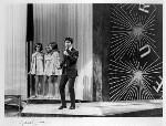 Sir Cliff Richard and 'The Breakaways' (Margo Quantrell; Vicki Haseman; Betty Prescott), by Michael Ward, 5 April 1968 - NPG  - © Michael Ward Archives / National Portrait Gallery, London
