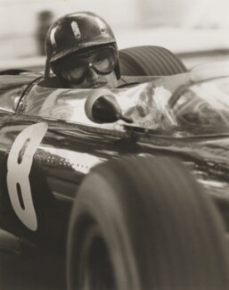 Graham Hill, by Colin Waldeck - NPG P544