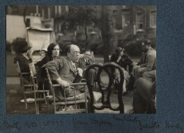 Group including James Stephens; Vivien and T.S. Eliot; Lady Huxley and Alberto Moravia, by Lady Ottoline Morrell - NPG Ax143428