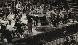 Yehudi Menuhin in rehearsal with an orchestra, by Ida Kar - NPG x128673