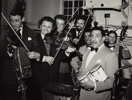 The Goons (Spike Milligan; Sir Harry Donald Secombe; Peter Sellers; Michael Bentine) with Ray Ellington and his band, by Walter Hanlon - NPG x128883