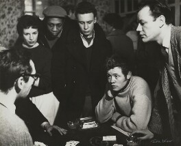 Frank Norman with five actors, including Dudley Sutton, rehearsing 'Fings ain't wot they used t'be', by Ida Kar - NPG x129544