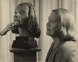 (Amy) Gwen Mond (née Wilson), Lady Melchett with her bust by Sir Jacob Epstein, by Ida Kar - NPG x129569
