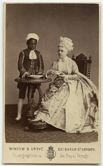 Marie Effie (née Wilton), Lady Bancroft as Lady Teazle and an unknown boy nicknamed 'Biafra' in 'The School for Scandal', by Window & Grove - NPG x131009