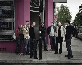 Belle & Sebastian (Stuart Murdoch; Stevie Jackson; Chris Geddes; Richard Colburn; Sarah Martin; Mick Cooke; Bobby Kildea), by Paul Stuart - NPG x131024