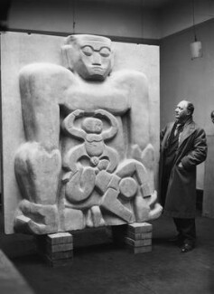 Jacob Epstein with 'Primeval Gods', by James Jarché, for  Daily Herald - NPG x88293