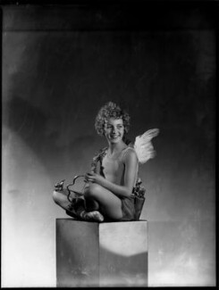 Helen ('Bunty') Kelley (later Bernstein) as Cupid in 'Queen of Hearts', by Bassano Ltd - NPG x153492