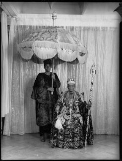 Ladapo Samuel Ademola II, King of Abeokuta and an unknown attendant, by Hay Wrightson, 11 June 1937 - NPG x132165 - © National Portrait Gallery, London