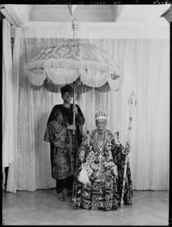 Ladapo Samuel Ademola II, King of Abeokuta and an unknown attendant, by Hay Wrightson, 11 June 1937 - NPG x132171 - © National Portrait Gallery, London