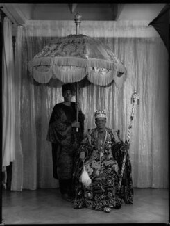 Ladapo Samuel Ademola II, King of Abeokuta and an unknown attendant, by Hay Wrightson, 11 June 1937 - NPG x132172 - © National Portrait Gallery, London