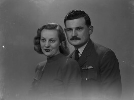 David William Anthony Blythe MacPherson, 2nd Baron Strathcarron; Valerie Cole, by Lenare - NPG x1324