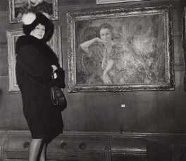 Barbara Goalen next to a portrait of herself by James Proudfoot, by Keystone Press Agency Ltd - NPG x1395