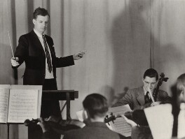 Benjamin Britten conducting the Suffolk (Long Island) Friends of Music Orchestra, by Unknown photographer - NPG x15196