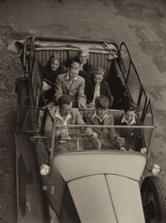 Benjamin Britten with the children of the original cast of 'Lets Make an Opera', by Kurt Hutton (Kurt Hubschman) - NPG x15220