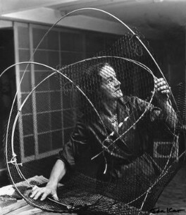 Barbara Hepworth at work on the armature of a sculpture, by Ida Kar - NPG x88517