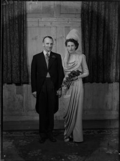 Margaret Elizabeth (née Robertson), Lady Silsoe; Malcolm Trustram Eve, 1st Baron Silsoe, by Bassano Ltd - NPG x43053