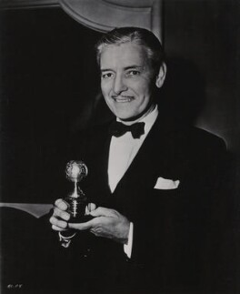 Ronald Colman with his Golden Globe award for his role in 'A Double Life', by Unknown photographer - NPG x6330