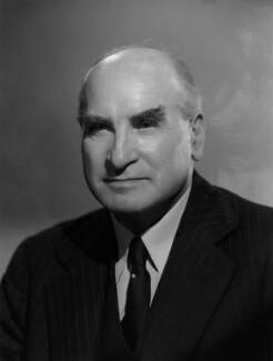 Sir Charles Carlow Reid, by Bassano Ltd - NPG x77742