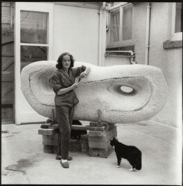 Barbara Hepworth with her cat Nicholas and her sculpture 'Reclining Form (Rosewall)', by Ida Kar - NPG x31619