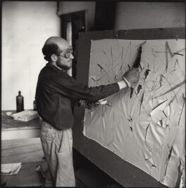 Gustav Metzger practicing for a public demonstration of Auto-destructive art using acid on nylon, possibly by John Cox, for  Ida Kar - NPG x134796