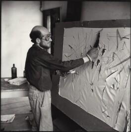 Gustav Metzger practicing for a public demonstration of Auto-destructive art using acid on nylon, possibly by John Cox, for  Ida Kar - NPG x134796
