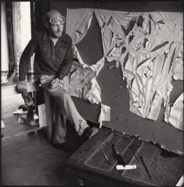 Gustav Metzger practicing for a public demonstration of Auto-destructive art using acid on nylon, possibly by John Cox, for  Ida Kar - NPG x134797