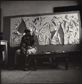 Gustav Metzger practicing for a public demonstration of Auto-destructive art using acid on nylon, possibly by John Cox, for  Ida Kar - NPG x134798