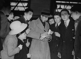 Fred Perry signing autographs at Victoria Station, by Edward Malindine, for  Daily Herald - NPG x135032