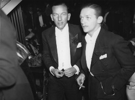 Noël Coward and Douglas Fairbanks Jr at the opening night of 'The Private Life of Henry VIII', by George Woodbine, for  Daily Herald - NPG x135048