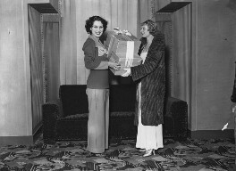 Anna Neagle presenting a prize to Mae Pope, winner of a Swan and Edgar competition, by Harold Tomlin, for  Daily Herald - NPG x135057