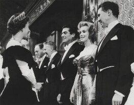 Queen Elizabeth II; Marilyn Monroe; Victor John Mature; Anthony Quayle, by Unknown photographer, for  Daily Mirror - NPG x136606